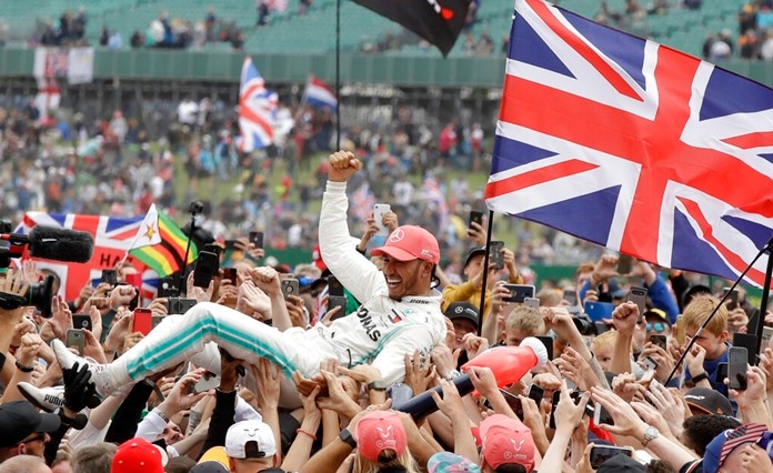 Mercedes driver Lewis Hamilton of Britain celebrates after winning the British Formula One Grand Prix at the Silverstone racetrack in Silverstone, England, Sunday, July 14, 2019. (AP Photo/Luca Bruno)