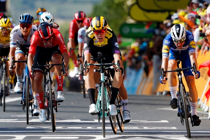 Belgium's Wout Van Aert, center, sprints to win the tenth stage of the Tour de France cycling race in Albi, France, Monday, July 15, 2019. (AP Photo/ Thibault Camus)