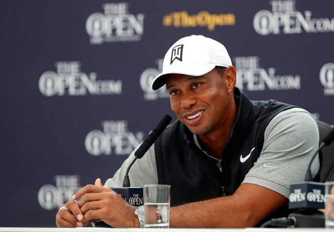 Tiger Woods of the United States speaks at a press conference ahead of the start of the British Open golf championships at Royal Portrush in Northern Ireland, Tuesday, July 16, 2019. The British Open starts Thursday. (AP Photo/Matt Dunham)