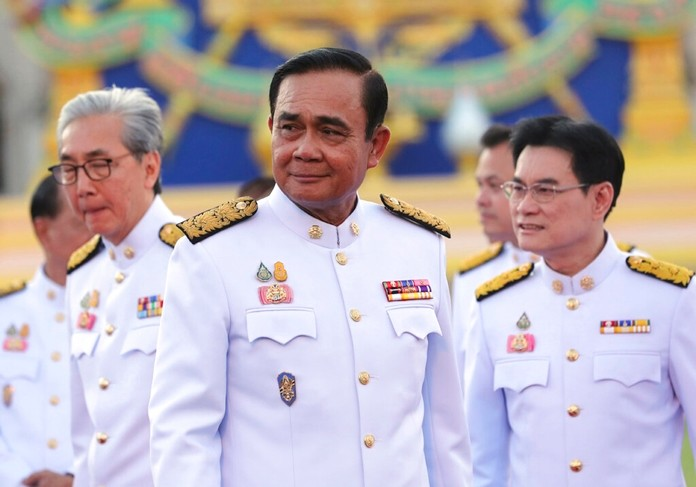 Prime Minister Prayuth Chan-ocha attends a group photo with his cabinet members at the Government House in Bangkok Tuesday, July 16, 2019. (AP Photo/Sakchai Lalit)