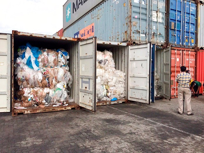 In this Tuesday, July 16, 2019, photo, containers loaded with plastic waste are shown in Sihanoukville Port, Cambodia. (AP Photo/Sea Seakleng)