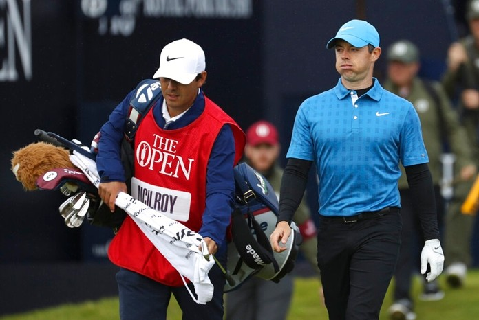 Northern Ireland's Rory McIlroy reacts after hitting his tee shot on the 1st hole into the long rough during the first round of the British Open Golf Championships at Royal Portrush in Northern Ireland, Thursday, July 18, 2019.(AP Photo/Peter Morrison)