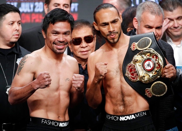 Manny Pacquiao, second from left, and Keith Thurman pose during a weigh-in Friday, July 19, 2019, in Las Vegas. The two are scheduled to fight in a welterweight championship boxing match Saturday in Las Vegas. (AP Photo/John Locher)