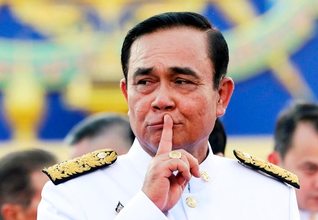 Thailand's Prime Minister Prayuth Chan-ocha gestures after a group photo with his cabinet members at the government house in Bangkok, Tuesday, July 16, 2019. (AP Photo/Sakchai Lalit)