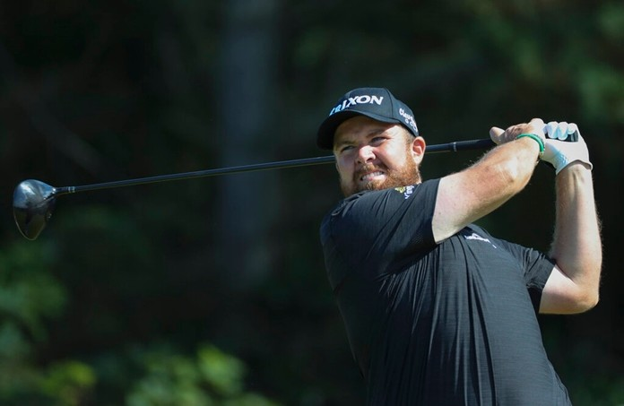 Ireland's Shane Lowry tees off on the 5th hole during the third round of the British Open Golf Championships at Royal Portrush in Northern Ireland, Saturday, July 20, 2019. (AP Photo/Peter Morrison)
