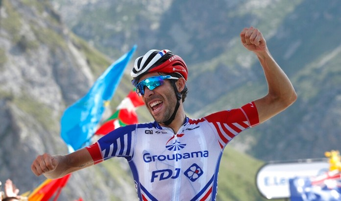 France's Thibaut Pinot celebrates as he crosses the finish line to win the fourteenth stage of the Tour de France cycling race at the Tourmalet pass, France, Saturday, July 20, 2019. (AP Photo/ Thibault Camus)