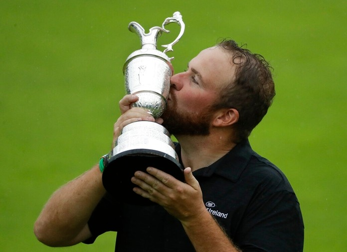 Ireland's Shane Lowry holds and kisses the Claret Jug trophy after winning the British Open Golf Championships at Royal Portrush in Northern Ireland, Sunday, July 21, 2019. (AP Photo/Matt Dunham)