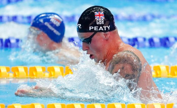 Britain's Adam Peaty swims in his heat of the men's 100m breaststroke at the World Swimming Championships in Gwangju, South Korea, Sunday, July 21, 2019. (AP Photo/Lee Jin-man)