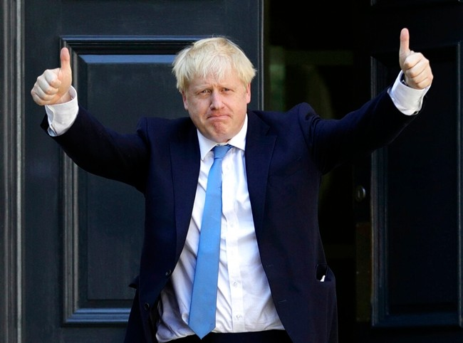 Newly elected leader of the Conservative party Boris Johnson arrives at Conservative party HQ in London, Tuesday, July 23, 2019. (Aaron Chown/PA via AP)