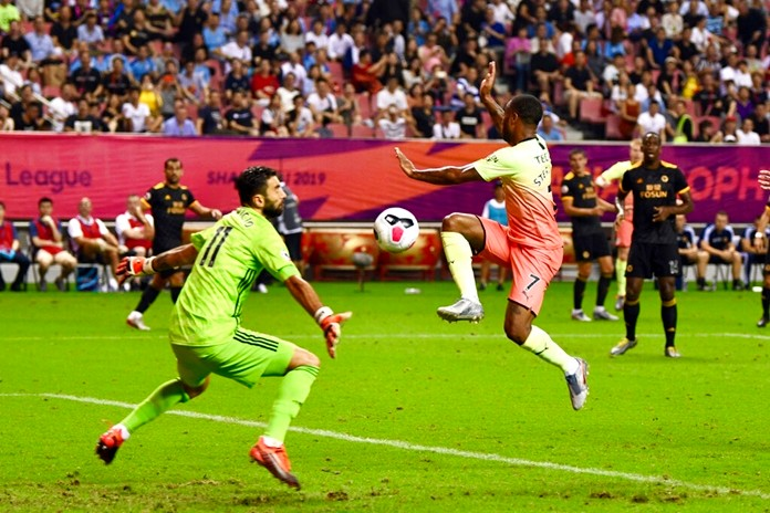 Wolverhampton Wanderers's goalkeeper Rui Patricio, left, blocks an attempt by Raheem Sterling of Manchester City in the final of the Premier League Asia Trophy in Shanghai, China, Saturday, July 20, 2019. (Chinatopix Via AP)