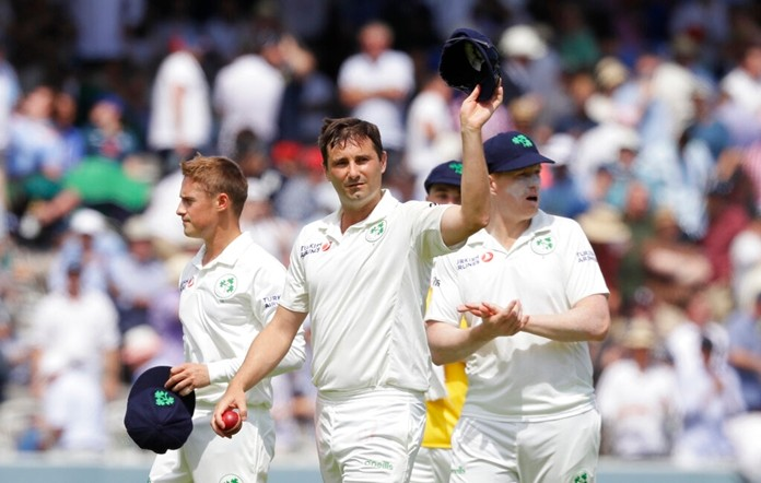 Ireland's Tim Murtagh holds up his hat to applause as he leaves the pitch after England are all out for 85 during the first day of the test match between England and Ireland at Lord's cricket ground in London, Wednesday, July 24, 2019. (AP Photo/Kirsty Wigglesworth)