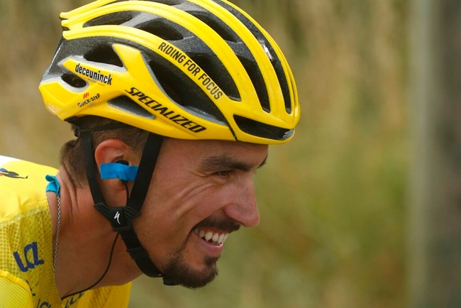 France's Julian Alaphilippe wearing the overall leader's yellow jersey smiles as he rides during the seventeenth stage of the Tour de France cycling race, Wednesday, July 24, 2019. (AP Photo/Thibault Camus)