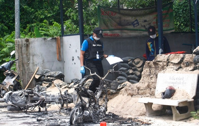 Police forensic officers examine the wreckage of motorcycle in Pattani province, southern Thailand, Wednesday, July 24, 2019. (AP Photo)
