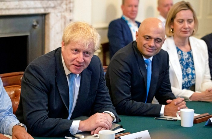 Britain's newly appointed Prime Minister Boris Johnson, left, holds his first Cabinet meeting, with Chancellor of the Exchequer Sajid Javid and Secretary for Work and Pensions Amber Rudd, right, at Downing Street in London, Thursday July 25, 2019. (Aaron Chown/Pool via AP)