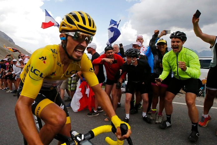 France's Julian Alaphilippe wearing the overall leader's yellow jersey climbs the Galibier pass during the eighteenth stage of the Tour de France, Thursday, July 25, 2019. (AP Photo/ Christophe Ena)
