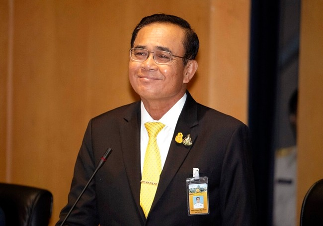 Prime Minister Prayuth Chan-ocha smiles during a parliamentary session in Bangkok, Thursday, July 25, 2019. (AP Photo/Sakchai Lalit)