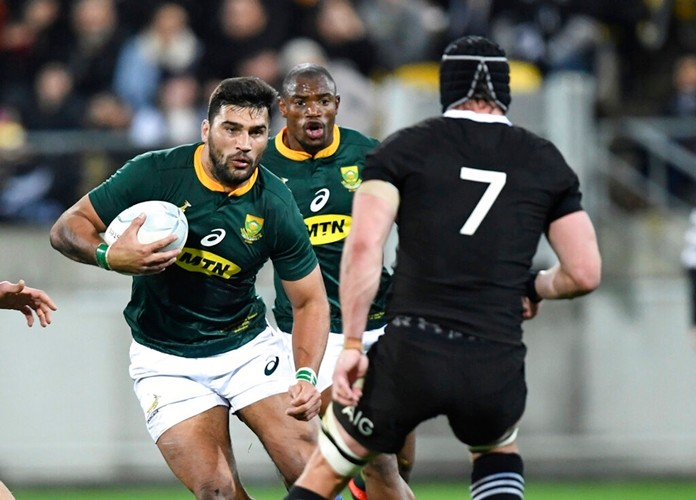 South Africa's Damian de Allende, left, steps inside New Zealand's Matt Todd during a rugby championship match between the All Blacks and South Africa in Wellington, New Zealand, Saturday, July 27, 2019. (AP Photo/Ross Setford)