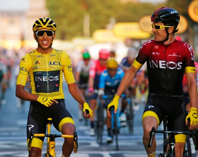 Colombia's Egan Bernal (left) wearing the overall leader's yellow jersey smiles as he crosses the finish line with Britain's Geraint Thomas after winning the Tour de France cycling race in Paris, France, Sunday, July 28, 2019. (AP Photo/Michel Euler)