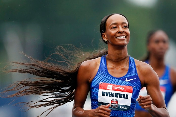 Dalilah Muhammad smiles as she wins the women's 400-meter hurdles at the U.S. Championships athletics meet, Sunday, July 28, 2019, in Des Moines, Iowa. (AP Photo/Charlie Neibergall)