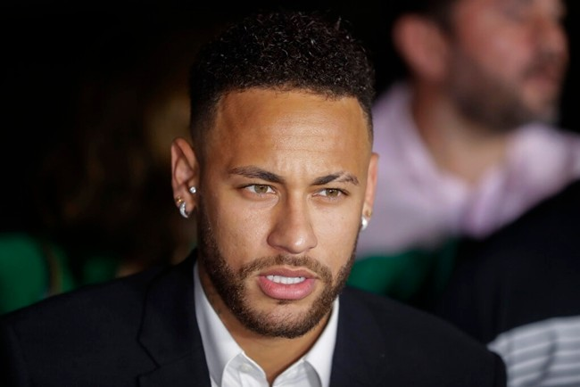 In this June 13, 2019 file photo, Brazil's soccer player Neymar speaks to the press as he leaves a police station in Sao Paulo, Brazil. (AP Photo/Andre Penner)