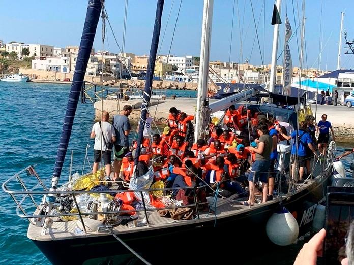 The Italian NGO Mediterranea Saving Humans' ship carrying 46 migrants docks in the port of Lampedusa, Sicily island, Italy, Saturday, July 6, 2019. (Elio Desiderio/ANSA via AP)