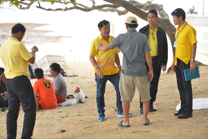 Deputy Mayor Pattana Boonsawad leads a delegation of city maintenance and environmental officials to Yom Beach to determine how much work is needed for a long-overdue cleanup.