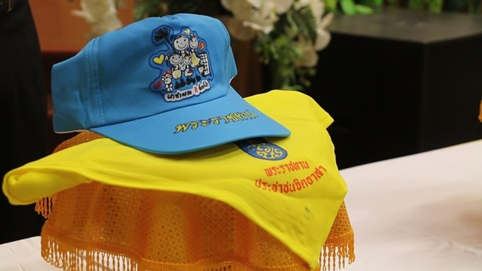 More than 500 Pattaya-area residents received royal caps and scarves for volunteering to work at HM the King's coronation in May.