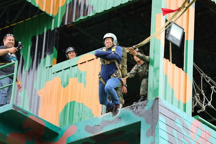 More than 200 village security officers, many terrified, jumped off a 10-meter tower to teach them to overcome fear.