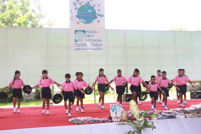 Human Help Network Thailand Director Radchada Chomjinda, her staff and 100 children thanked the guests and the kids put on a stage show.