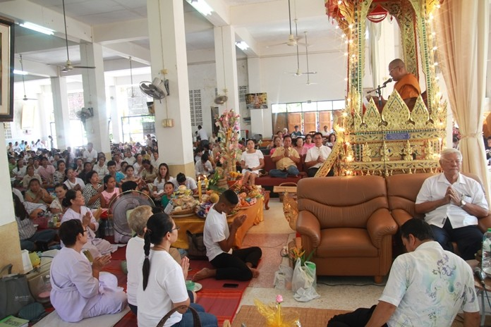 Devout Buddhists listen to a sermon at Wat Khao Saothongtong on Asalaha Bucha Day.