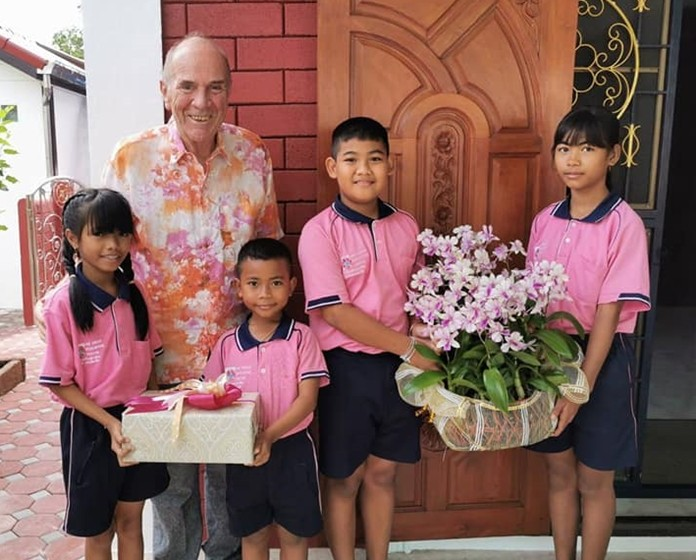 Children from the Drop-In Center brought gifts and flowers for Otmar Deter on his birthday.