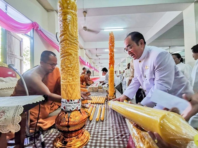 """Nongprue community organizations and schools contributed handmade candles destined for seven temples for use during the three months """"rains retreat""""."""