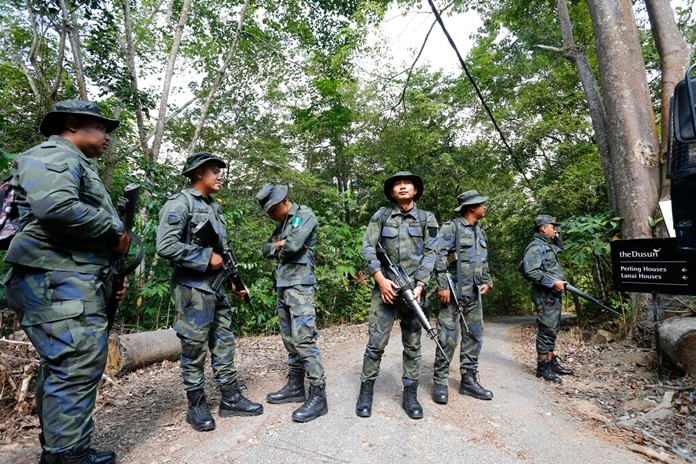 Members of General Operations Force arrive to join a search operation for a missing 15-year-old London schoolgirl at The Dusun resort in Seremban, Negeri Sembilan, Malaysia, Monday, Aug. 5, 2019. (AP Photo/Lai Seng Sin)