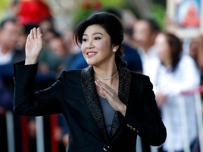 Former Prime Minister Yingluck Shinawatra waves to supporters as she arrives at the Supreme Court in Bangkok, Thailand Tuesday, Aug. 1, 2017. (AP Photo/Sakchai Lalit, file)