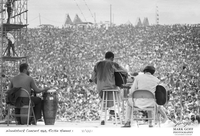 This August, 1969 photo shows Richie Havens as he performs during Woodstock in Bethel, N.Y. The photo is only one of hundreds made by photographer Mark Goff who, at the time, worked for an underground newspaper in Milwaukee, Wis. (Mark Goff Photography, Leah Demarco/Allison Goff via AP)
