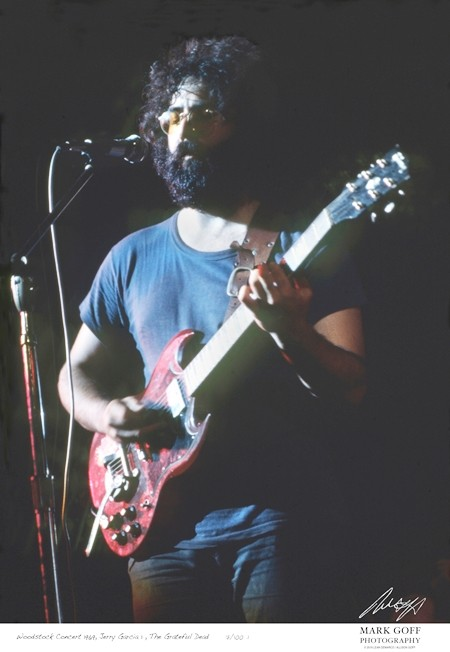 This August, 1969 photo shows Jerry Garcia as he performs during Woodstock in Bethel, N.Y. (Mark Goff Photography, Leah Demarco/Allison Goff via AP)