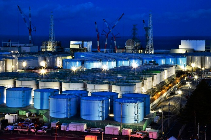 This Jan. 25, 2019, photo shows water tanks containing contaminated water that has been treated at the Fukushima Dai-ichi nuclear plant in Okuma town, Fukushima prefecture, northeastern Japan. (Kyodo News via AP)