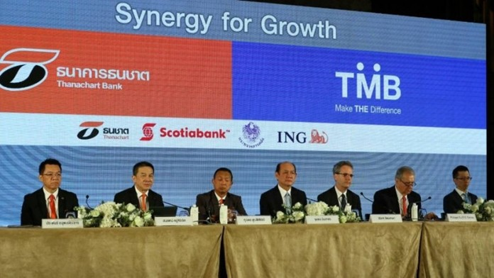 A press conference was held to announce the merger of Thanachart and Thai Military Banks.