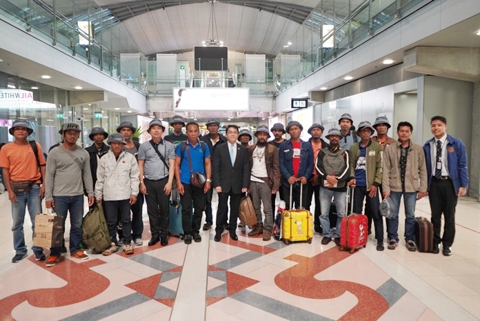 The stranded fishing crew arrive back to Thailand.