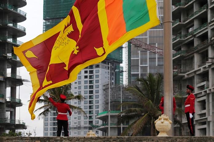 The Sri Lankan national flag flies at the popular landmark Galle Face in Colombo, Sri Lanka. (AP Photo/Eranga Jayawardena)