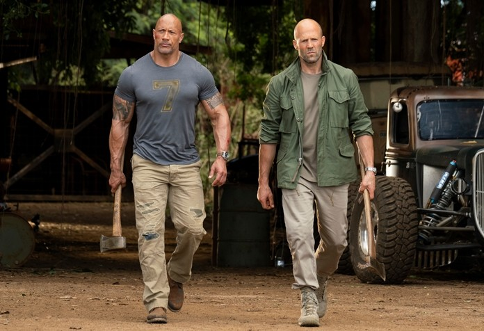 "This image shows Dwayne Johnson (left) and Jason Statham in a scene from ""Fast & Furious Presents: Hobbs & Shaw."" (Frank Masi/Universal Pictures via AP)"