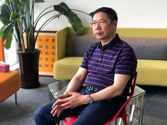 Prof. Du Huanzheng, director of Research Institute of Recycled Economy at Tongji University, speaks during an interview in Shanghai. (AP Photo/Chen Si)