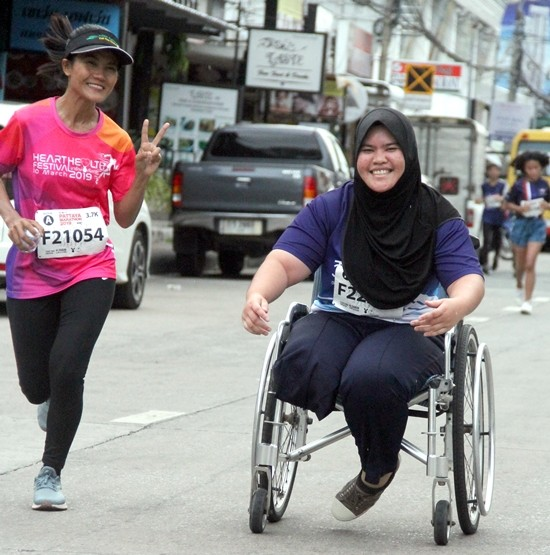Wheelchair athletes and able-bodied runners competed side by side and had great fun along the way.