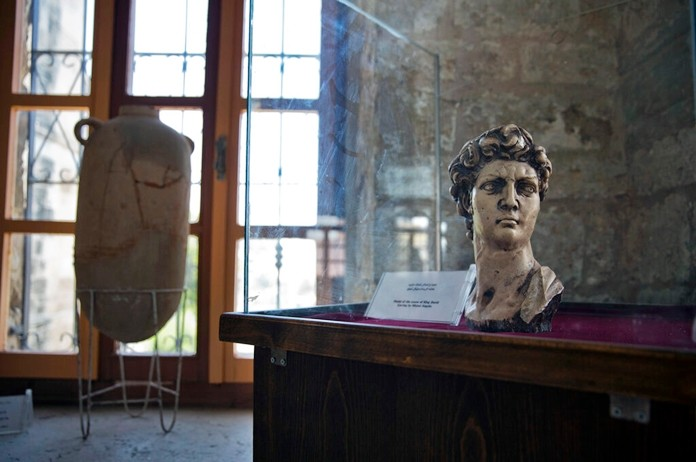 An ancient bust of King David is displayed inside the historical Pasha Palace run by Gaza's Ministry of Tourism and Antiquities, in Gaza City July 16, 2019. (AP Photo/Khalil Hamra)