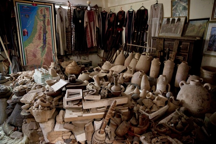 Palestinian heritage pieces and ancient artifacts are piled inside Al-Aqqad private museum in town of Khan Younis, Southern Gaza Strip July 14, 2019. (AP Photo/Khalil Hamra)