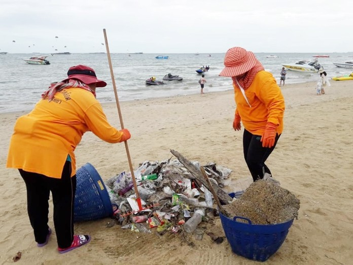 Sanitation workers working hard to clean up our beaches.