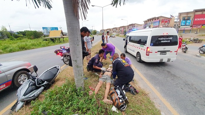 Rescue personnel tend to the severely injured biker.
