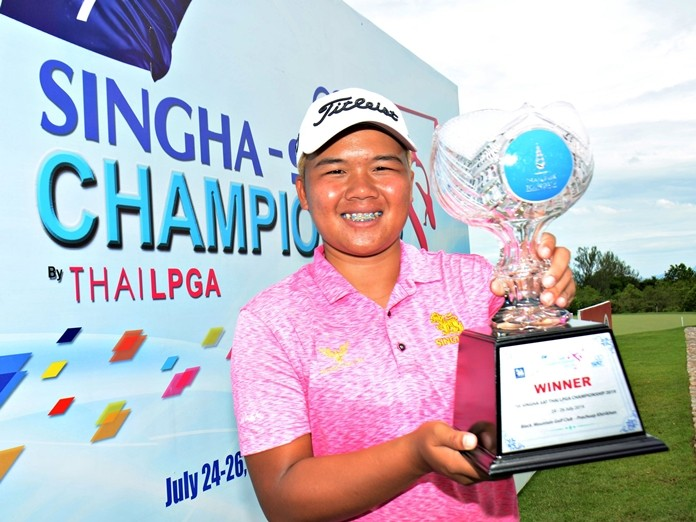 Kusuma Meechai poses with the trophy after winning the Singha Thai LPGA Tour event at Black Mountain Golf Club in Hua Hin on July 26, 2019.