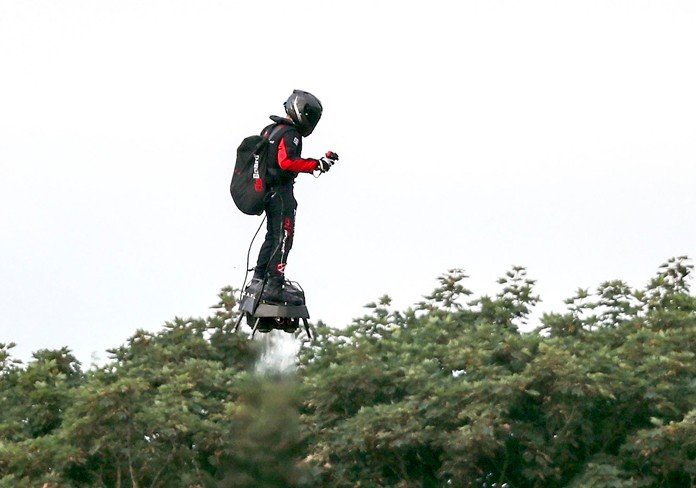 Franky Zapata, a 40-year-old inventor, takes to the air in Sangatte, Northern France, at the start of his successful attempt to cross the channel from France to England, aboard his flyboard, Sunday Aug. 4, 2019. (AP Photo/Michel Spingler)