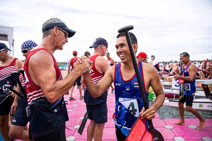 A Thai rower is congratulated by his American counterpart at the conclusion of a race.
